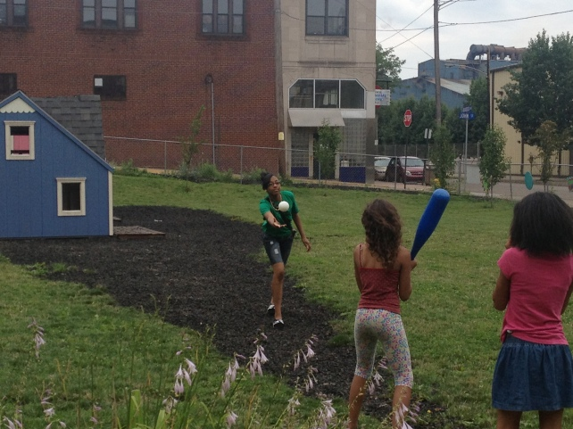 Cafe Team Plays Baseball With Playground Kids